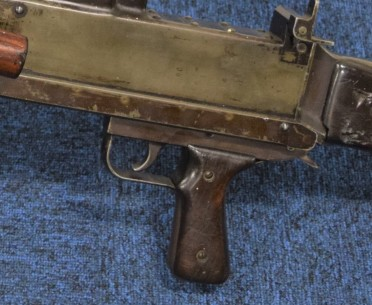 A close up of the BESAL's pistol grip and trigger - note the release lever behind the grip to unlock the grip for cocking