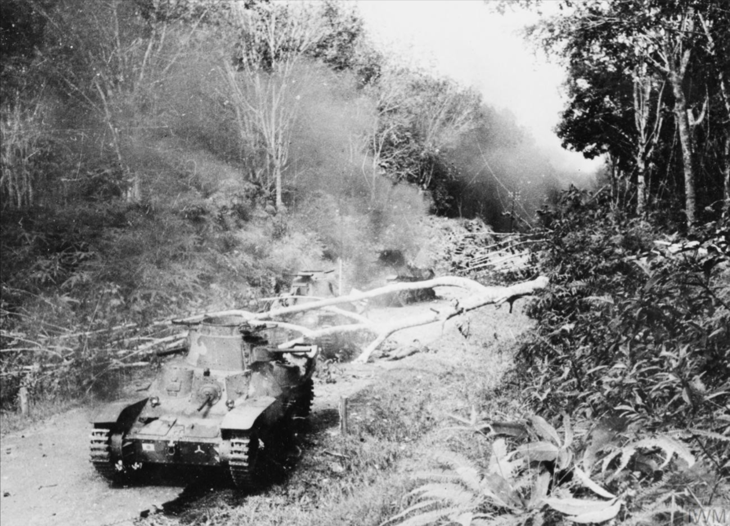 Knocked-out Japanese Type 95 Ha-Go tanks at a roadblock across the Muar - Parit Sulong road jan 42 - iwm