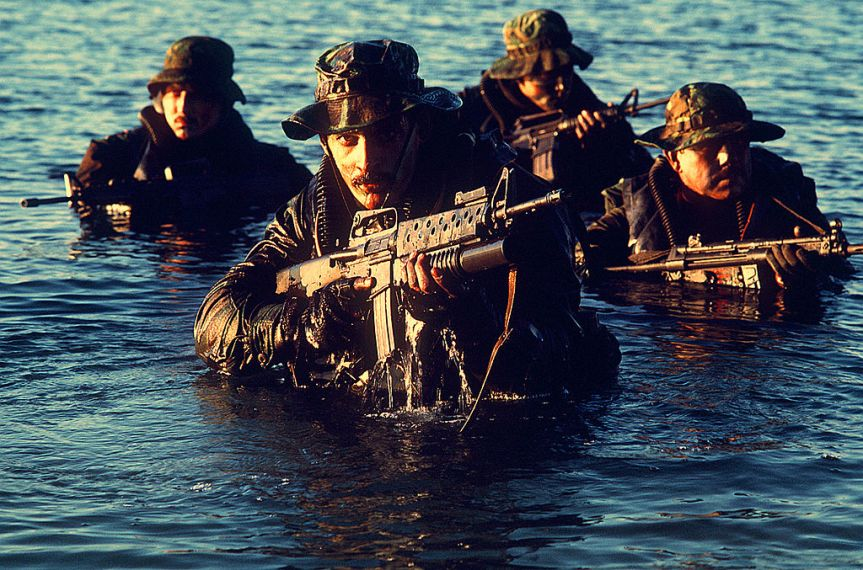 Navy_SEALs_coming_out_of_water.JPEG